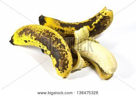 Over ripe banana skin on white background
