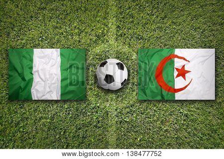 Nigeria Vs. Algeria Flags On Soccer Field