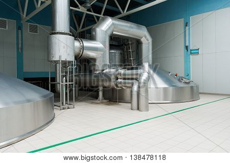 Steel fermentation vats on brewer factory facility