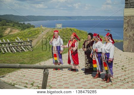 Tetyushi, Tatarstan, Russia - June 23, 2016. Folk group meet with Russian songs the passengers from passenger ship