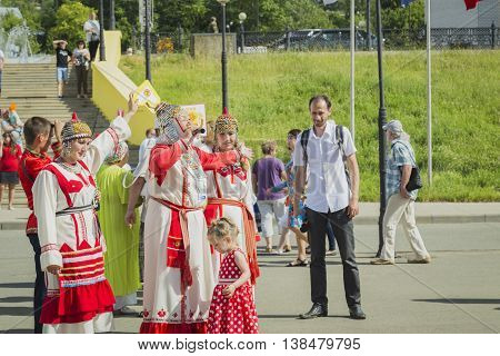 Cheboksary, Chuvashia, Russia - June 24, 2016 Folk group meet with Russian songs the passengers from passenger ship