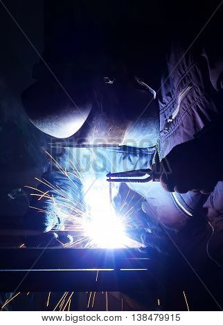 Welding and bright sparks. Hard job concept and idea