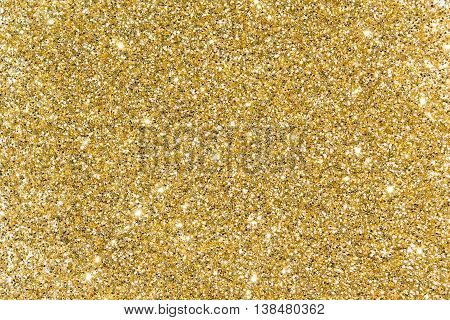Gold sequins Bright shine. Yellow powder. Glitter. Shining background