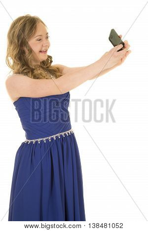 a woman with down syndrome in a fancy blue dress holding on to her phone to take a picture of her.