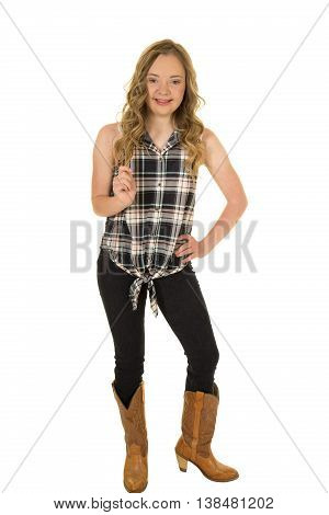 a cowgirl with down syndrome playing with her hair with a big smile.