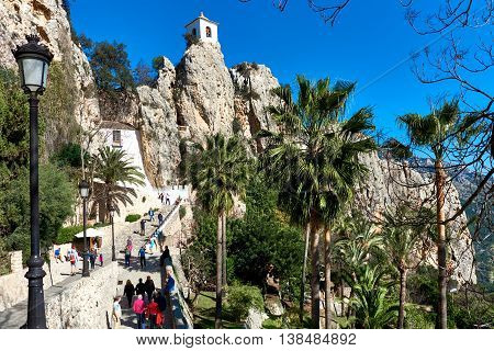 Guadalest Spain- February 2 2016: Tourists walking up to mountain of Guadalest. Guadalest is a small village on the Costa Blanca. Guadalest has been declared a