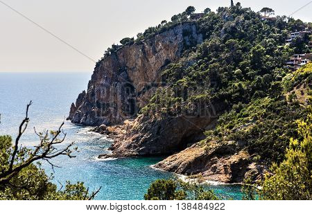 Rocky seaside of Cala Giverola. Tossa de Mar town. Province of Girona. Spain