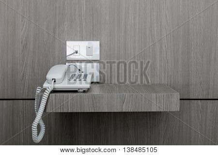 White telephone on a table wood floor