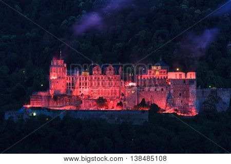 Red illumination of the old castle Heidelberg Germany