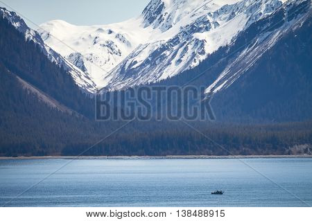 Small Ship within Great Alaskan Wilderness in United States