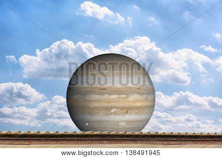 Planet Jupiter On The Blue Sky
