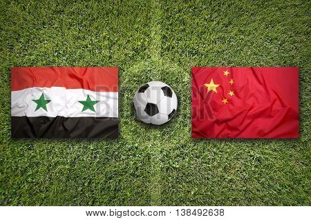 Syria Vs. China Flags On Soccer Field