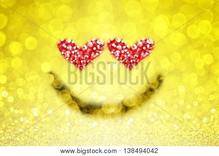 Abstract yellow emoji emoticon smiley face background with sparkle heart eyes for love
