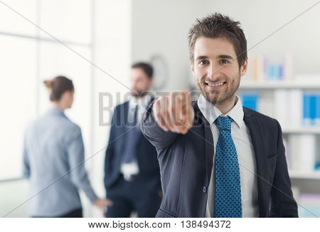 Smiling Businessman Pointing At Camera