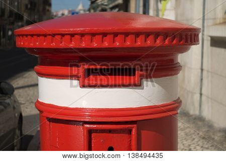 A classic red letter box in Lisbon, Portugal.