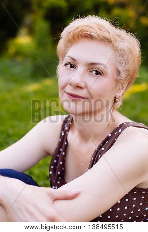 Portrait Of Middle Aged Woman Smiling In The Park