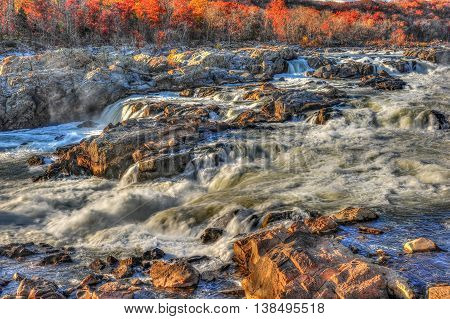 Waterfalls and rapids of Great Falls Maryland in Autumn during sunset
