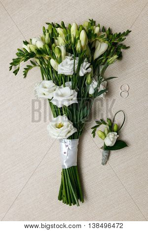 wedding Bridal bouquet and boutonniere for the groom and ring