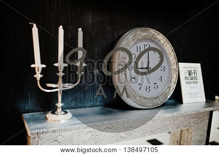 Vintage Candlestick With Silver Clock At 9 Am