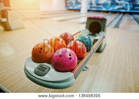 A Group Of Colored Bowling Balls At Bowl Lift