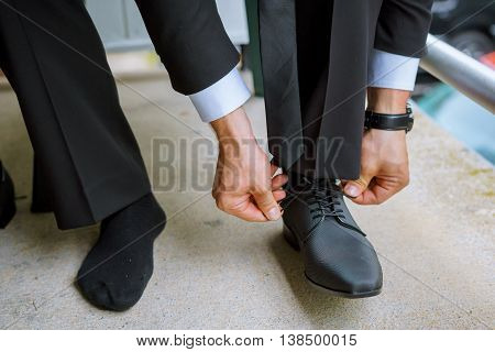 Hands Of Wedding Groom Getting Ready Suit