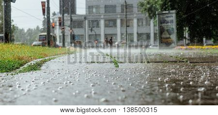 Wide picture of bubbles in a puddle of rain during a heavy rain.