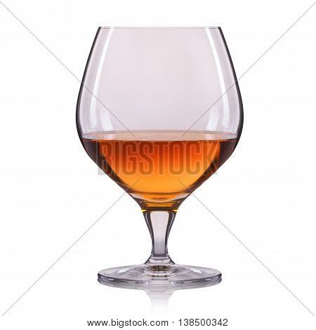 Splash of cognac in glass on white background.