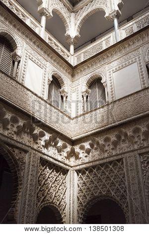 SEVILLE, SPAIN - September 12, 2015: Detail of the majestic plaster decoration of the Patio de las Munecas Alcazar of Sevilla on September 12, 2015 in Seville, Spain