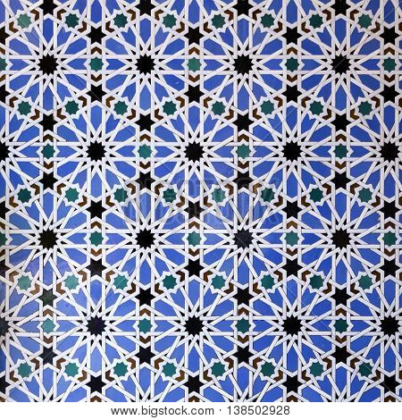 The classic geometric pattern of the Moorish tiles in the Alcazar of Seville Spain