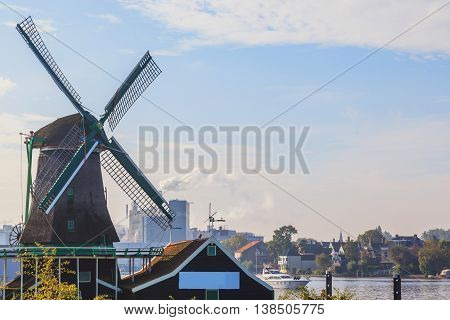 Historic native Dutch wind mill with cityscape