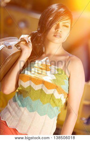 Beautiful hispanic woman carrying suitcase