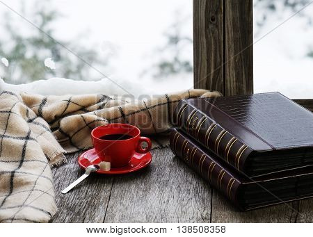 Red Cup Of Coffee Or Tea On A Stylized Wooden Windowsill.