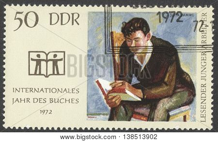 MOSCOW RUSSIA - CIRCA JANUARY 2016: a post stamp printed in DDR devoted to the International Book Year circa 1972