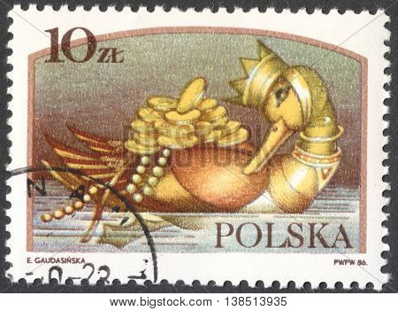 MOSCOW RUSSIA - CIRCA FEBRUARY 2016: a post stamp printed in POLAND shows the golden Duck the series