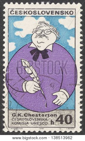 MOSCOW RUSSIA - CIRCA FEBRUARY 2016: a post stamp printed in CZECHOSLOVAKIA shows a portrait of G.Chesterton the series