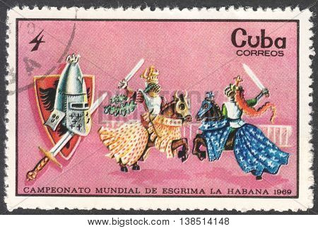 MOSCOW RUSSIA - CIRCA FEBRUARY 2016: a post stamp printed in CUBA shows medieval knights fencing the series