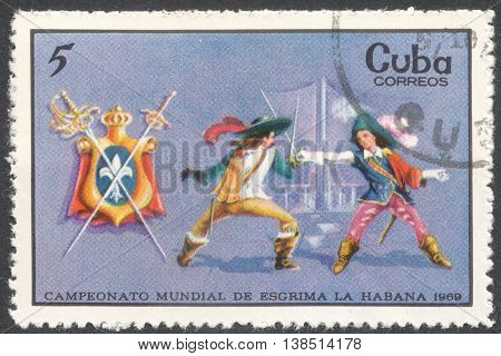 MOSCOW RUSSIA - CIRCA FEBRUARY 2016: a post stamp printed in CUBA shows musketeer fencing the series