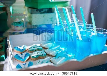 Candy bar on wedding ceremony with a lot of different candies and beverages.