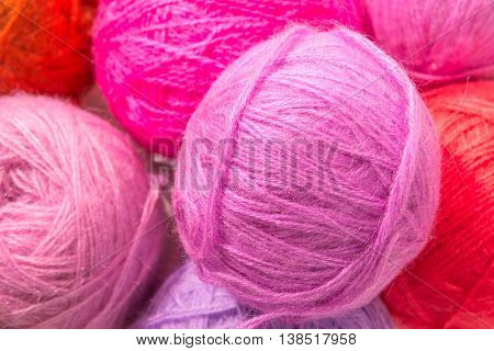 Red And Pink Woolen Skeins Of Thread Closeup