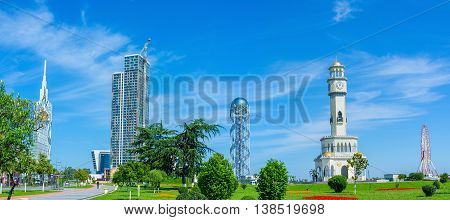 BATUMI GEORGIA - MAY 25 2016: Panorama of the beautiful garden in Batumi with the modern buildings and ferris wheel on the background on May 25 in Batumi Georgia.