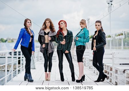 Group Of Sexy Models Girls In Black Bra And Leather Jackets On The Dock
