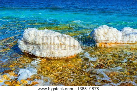 The scenic nature of the Dead Sea with unusual stones covered the crystals of salt Ein Gedi Israel.