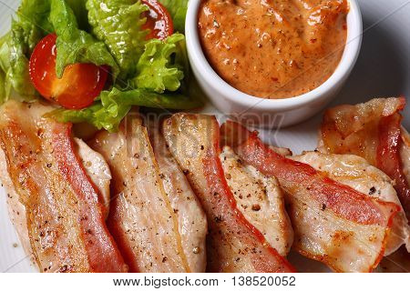 Slices of Prosciutto on old wooden background. Top view.