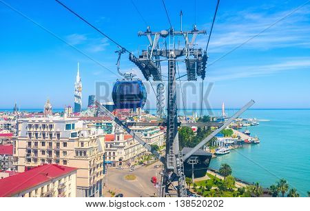 The Cableway tower with the moving lift and the city center on the background Batumi Georgia.