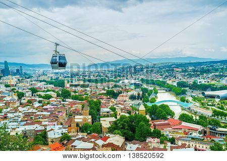 The cable car is the best choice to discover city from the top and get to the Narikala Fortress Tbilisi Georgia.