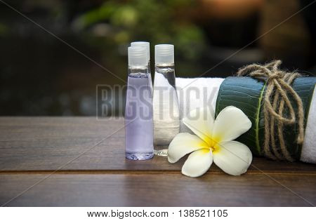 Spa massage compress balls, herbal ball on the wooden with treaments spa , Thailand, soft focus