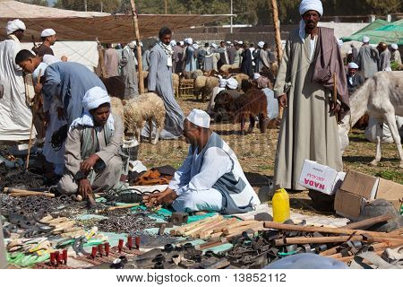 DARAW, EGYPT - DECEMBER 29: Arab people are bargaining at weekly camel and livestock market on Dece