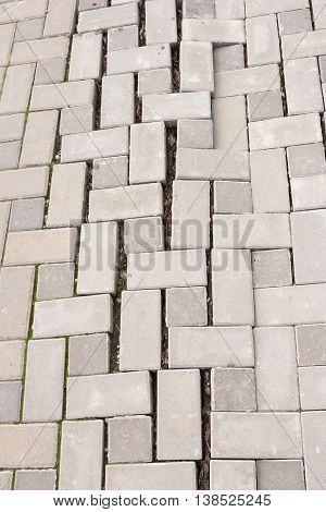 A large crack in the paving tiles