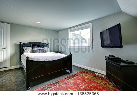 Classic American Bedroom With Green Walls And Black Furniture