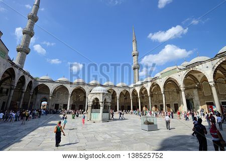 ISTANBUL - AUGUST 7: People waiting to enter the Sultan Ahmed Mosque, August 7, 2013 in Istanbul, Turkey. Sultan Ahmed Mosque (Blue Mosque) on of most popular tourist attractions in Istanbul.